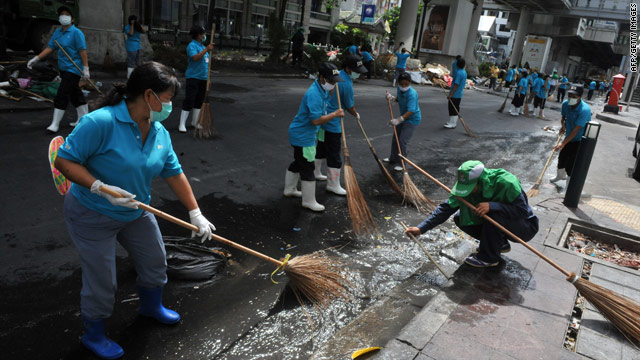 Workers and volunteers clean up downtown Bangkok on Sunday.