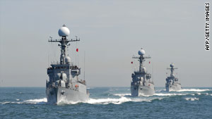 South Korean patrol vessels stage an anti-submarine exercise Thursday off the western coastal town of Taean.