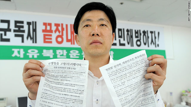 Park Sang Hak, an activist and former defector from North Korea, shows anti-Pyongyang leaflets as he prepares propaganda in Seoul.