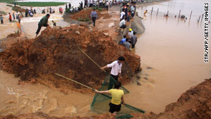 Villagers build a temporary dam at their field after a rain storm hit China's Guangxi province.