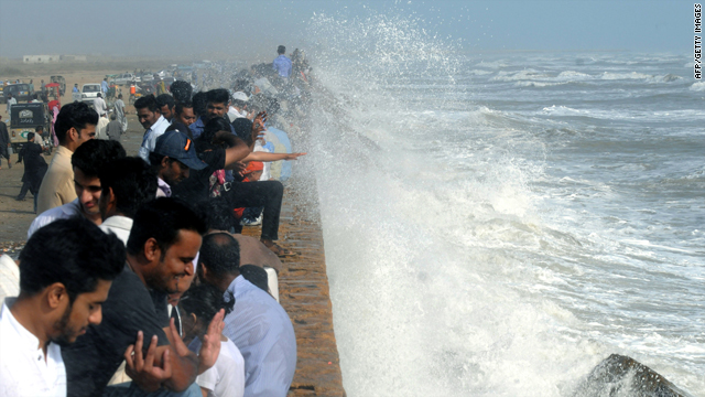Pakistani onlookers throng the popular Seavies beach along the Arabian Sea as high tides lash its shores in Karachi on Friday.