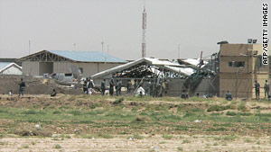 Police inspect a training center in Kandahar that was attacked Monday, leaving two people dead.