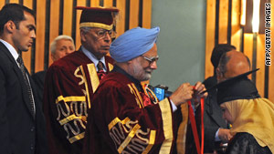 Indian PM Manmohan Singh gives a medal to a student during a function in Srinagar on June 7, 2010.