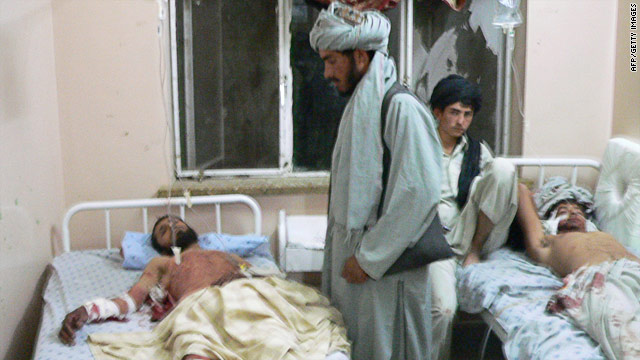 Victims of an attack on a wedding ceremony in Afghanistan's Kandahar province receive hospital treatment, June 10, 2010.