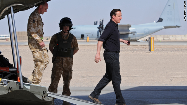 British Prime Minister David Cameron, right, arrives at Camp Bastion in Helmand Province, Afghanistan on Thursday during his his first visit to Afghanistan since taking office.