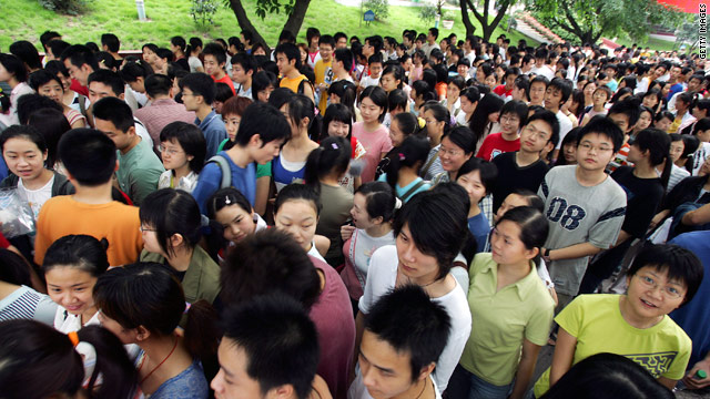 Students wait outside exam rooms before they take part in the National College Entrance Examination in Chongqing Municipality, China, in 2005.