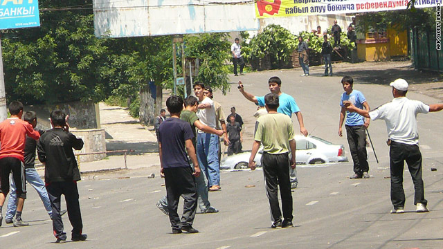 Factions argue in the streets of Osh, Kyrgyzstan, on Friday, where violence has left at least 37 people dead.