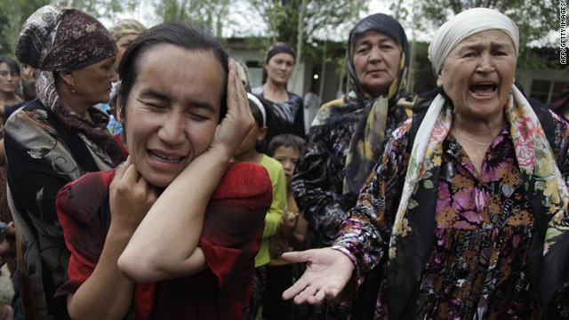 Ethnic Uzbek women plea for help at a refugee camp outside of Osh on Tuesday.