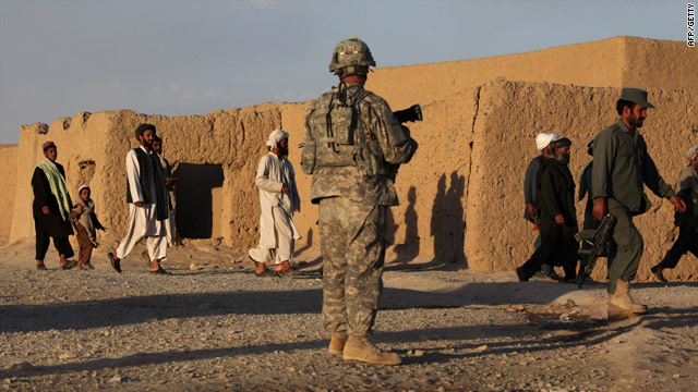 Civilians leave a street in Kandahar City, Afghanistan, on June 14 during a U.S. Army operation.