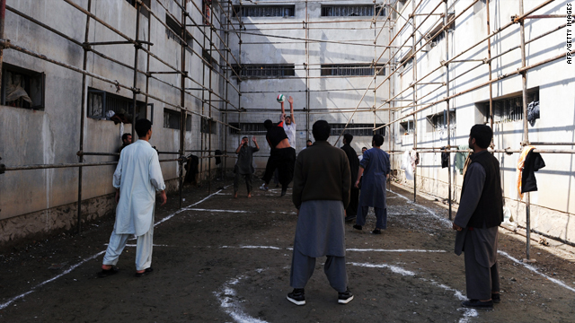 In this March 7, 2010 photograph, Afghan prisoners show their volleyball skills to local and international media at Pul-e Charkhi prison on the outskirts of Kabul.