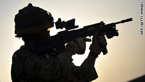 Rifleman Kesh Hurung, from Britain's Royal Gurkha Rifles, aims his weapon Thursday in Nahr e Saraj, Afghanistan.