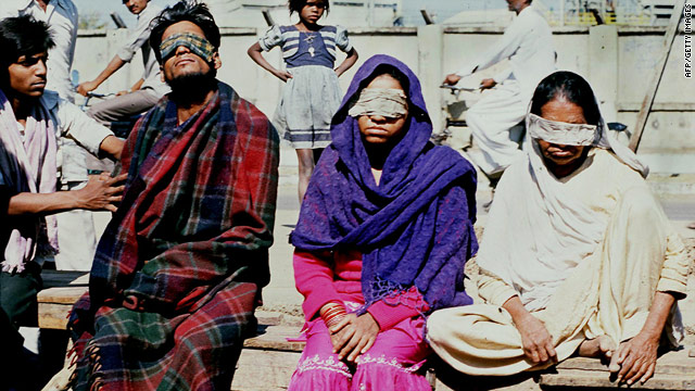 A file photo taken December 4, 1984, shows victims who lost their sight in the Bhopal poison gas tragedy.
