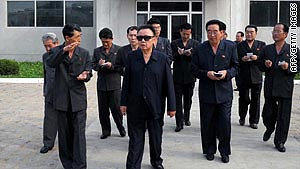 An undated picture shows Kim Jong Il inspecting the Rakwon Machine Complex in North Pyongan province.
