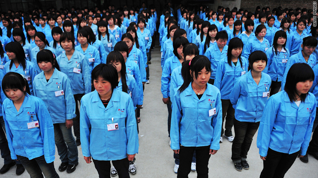 Workers prepare to depart for a factory at the Shenzhen Quanshun Human Resources Co. Ltd. on February 26, 2009, in Shenzhen, Guangdong Province.