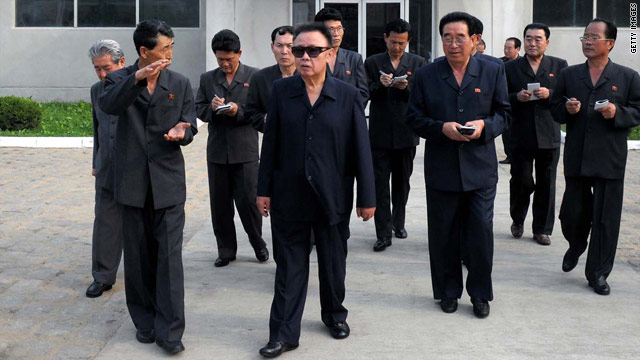 This undated picture, released from Korean Central News Agency on  June 19, 2010 shows North Korean leader Kim Jong Il (C) inspecting the  Rakwon Machine Complex in North Pyongan province.