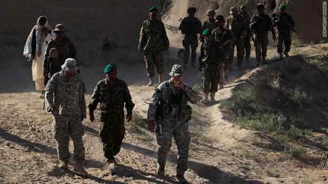 Afghan Police, Afghan Army, and NATO troops walk on an informational mission Friday in Bala Murghab, Afghanistan.