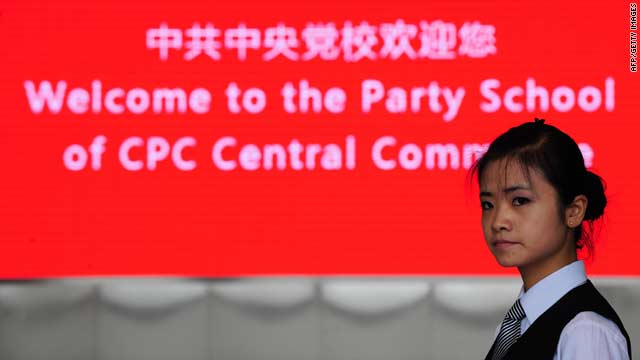 A hostess awaits the arrival of visiting journalists at the Central Party School of the Communist  Party in Beijing on Wednesday.