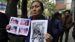 A petitioner outside the Chongqing, China, court in April shows photos of crimes allegedly committed by Wen Qiang.