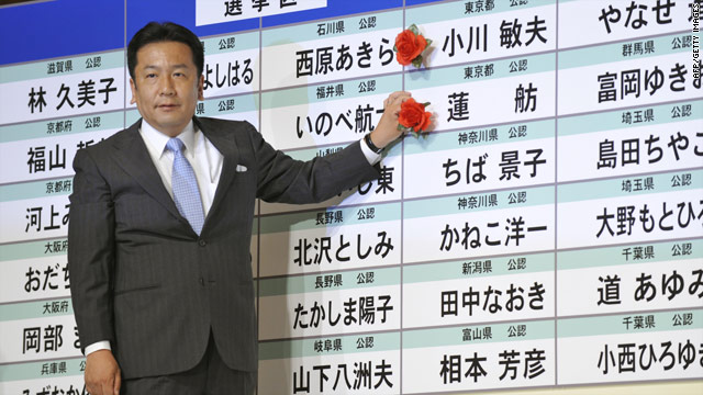 Yukio Edano, DPJ Secretary General, puts a victory rose on the DPJ candidate list at the party's campaign headquarters on July 11, 2010.
