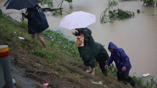 Residents escape a flooded area Luozhen township, China, last month.