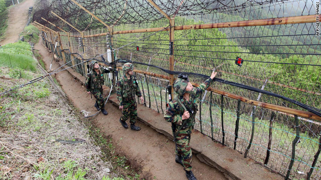 South Korean soldiers patrol along the DMZ.