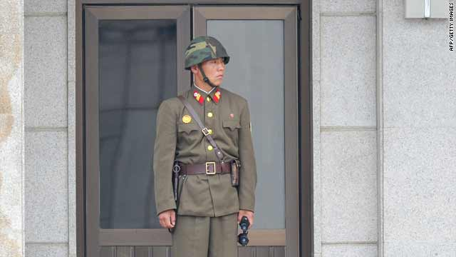 A North Korean soldier looks at the truce village of Panmunjom in the demilitarized zone (DMZ) on Wednesday.