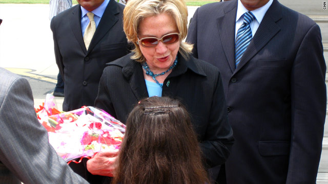 Hillary Clinton is greeted by a well-wisher after her arrival in Islamabad on Sunday.