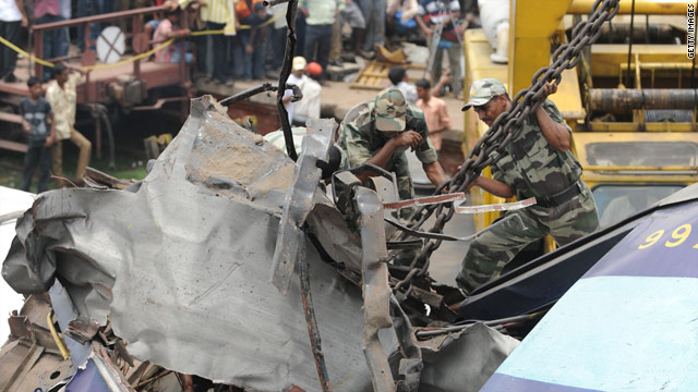 Indian rescue personnel work at the scene of the railway accident on Monday.