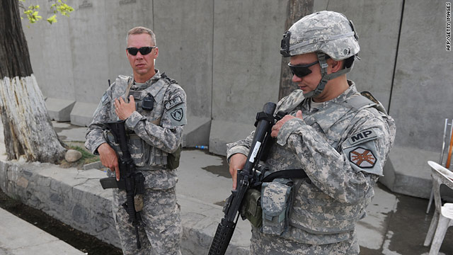 Two U.S. soldiers stand guard in Kabul, Afghanistan, on Sunday after two U.S. troops were abducted.