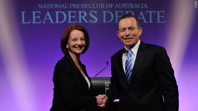 Australian Prime Minister Julia Gillard and opposition leader Tony Abbott ahead of the leaders' debate on July 25 in Canberra.