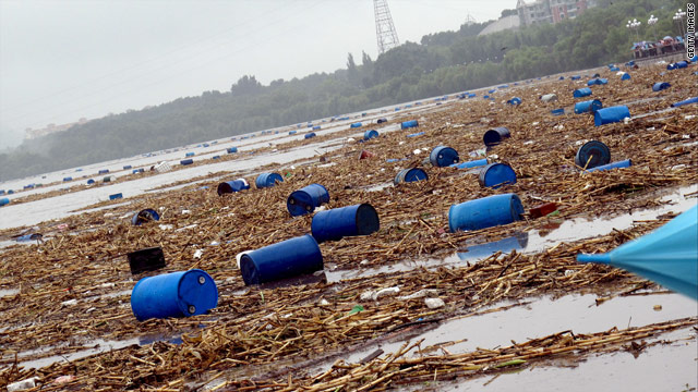 Barrels from a chemical plant float in the Songhua river in Jilin on July 28, 2010.