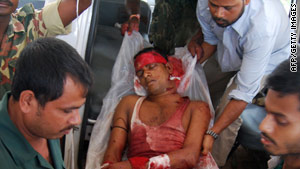 An injured reserve police officer arrives at a hospital Friday in India's Assam state.
