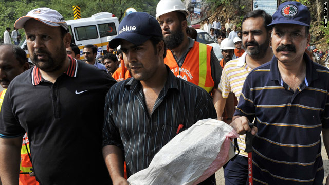 A Pakistani official carries the black box from the crashed Airblue passenger plane at the Margalla Hills on the outskirts of Islamabad on July 31, 2010.