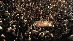 The body of a boy killed in clashes Monday is carried through the streets of Srinagar, India.