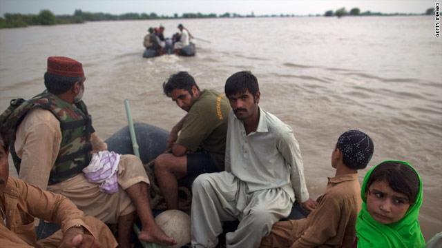 The Pakistan Navy rescues a family on August 6, 2010 in the village of Panu Akil, near Sukkur, Pakistan.