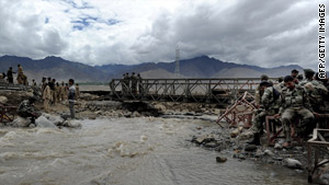 The Indian army has been helping flood victims. Here, army personnel rest after setting up a temporary bridge in Leh.