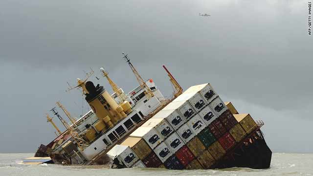 An aircraft flies over the damaged cargo ship MSC Chitra off the Mumbai coast on Monday.