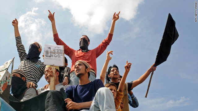 Kashmiri Muslim protesters shout pro-freedom slogans during an anti-India protest in Srinagar on August 12.