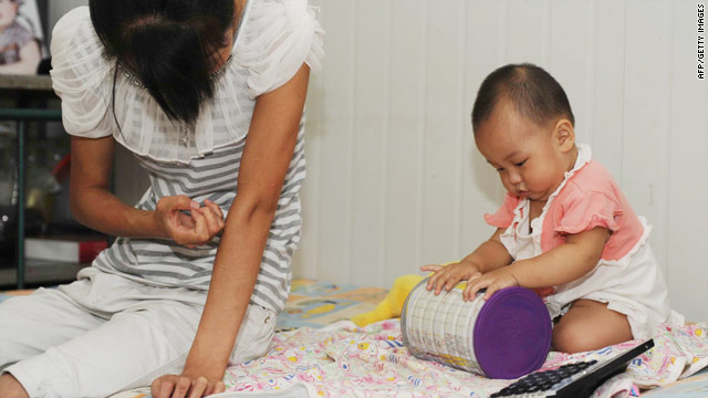 Thirteen-month-old  Xiaoying with her mother in Beijing on August 9 after being  diagnosed with premature breast growth.