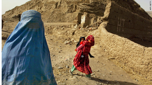 A file photograph of an Afghan woman in Kunduz province, where the Taliban stoned and man and a woman to death Sunday.