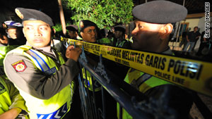 Police seal a raided home in West Java province, on May 12. Five suspected terrorists were killed in raids in Indonesia.