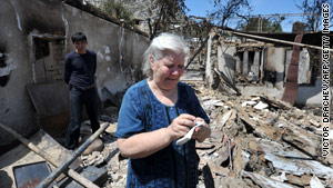 At its peak, the ethnic violence displaced 300,000 people, including this woman, who lost her home in Osh.