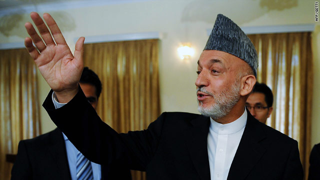 Afghan president Hamid Karzai waves as he leaves a press conference at the Presidential Palace in Kabul on July 29, 2010.