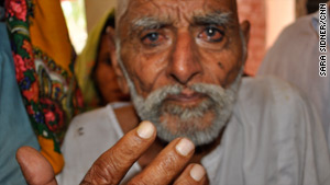 The family of great-grandfather Busar Jatoi, pictured, rescued him in the floods.