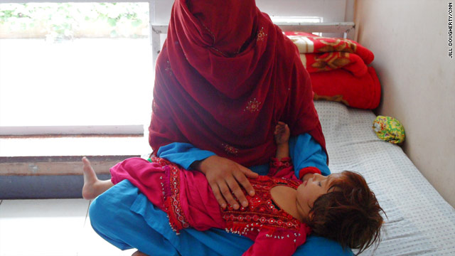 A mother and child at a drug treatment center in the back street of Kabul where many go to fight addictions to heroin and opium.