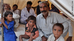 Some members of the extended Ayoob family in their tent at the relief camp near Karachi.