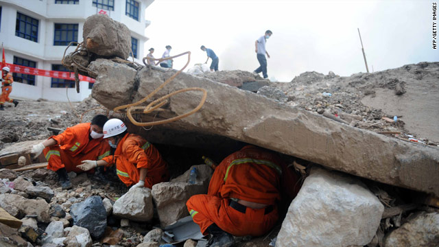 On August 12, 2010, rescuers search the rubble after the massive landslide in Zhouqu, northwest China's Gansu province.