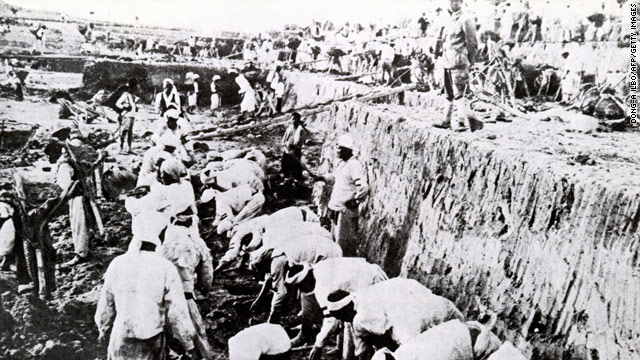 A photo from 1937 shows Koreans working in a gold mine under the watchful eye of Japanese soldiers.