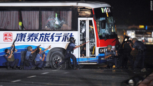 Police start charging the bus in Manila, Philippines, after a former police officer took a group of tourists hostage.