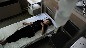 An Afghan schoolgirl suffering from suspected poisoning receives treatment Wednesday at a hospital in Kabul.